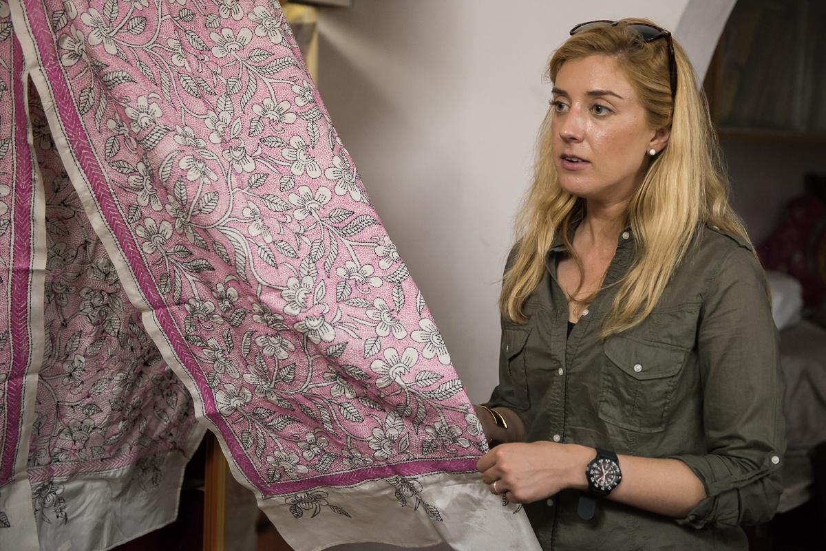 Jane reviewing fabric in Kolkata.jpg
