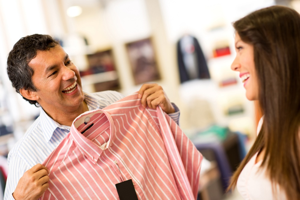 Happy couple in a store shopping for shirts.jpeg